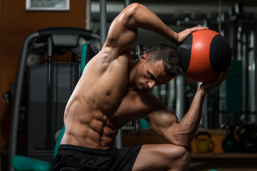 Muscular Man Exercise With Medical Ball