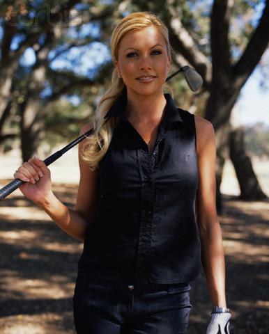 Actress Lisa Dergan Holding Golf Club