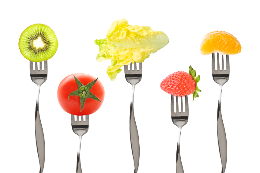 Forks with fruits and vegetables isolated on white background