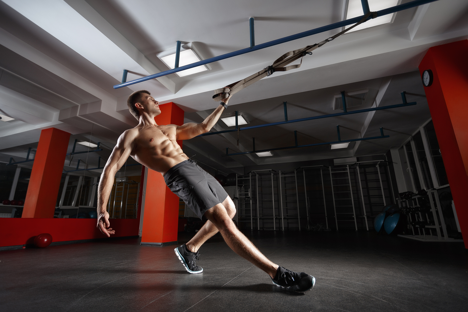 Fitness man workout on the rings HIIT workouts.